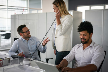 Business people working in office. Business woman talking on Landline phone.