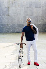 Trendy black man with bicycle