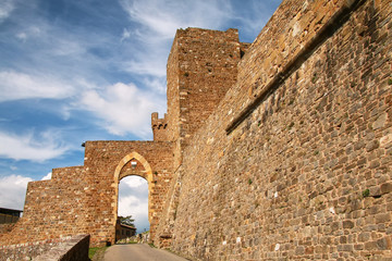 Gate to the town and Montalcino Fortress wall in Val d'Orcia, Tuscany, Italy