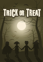 Trick or treat. Group of children in the forest on Halloween night