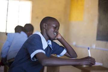 School girl studying in classroom. Kenya, Africa.