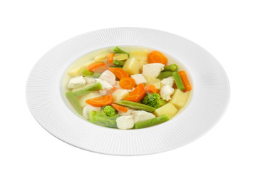 Plate with delicious turkey soup on white background