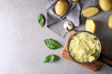 Composition with mashed potatoes in pot on table