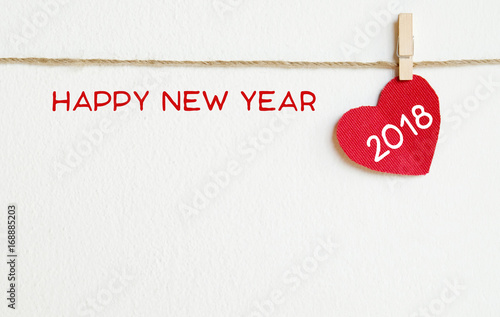 red fabric heart with happy new year 2018 word hanging on the clothesline new year