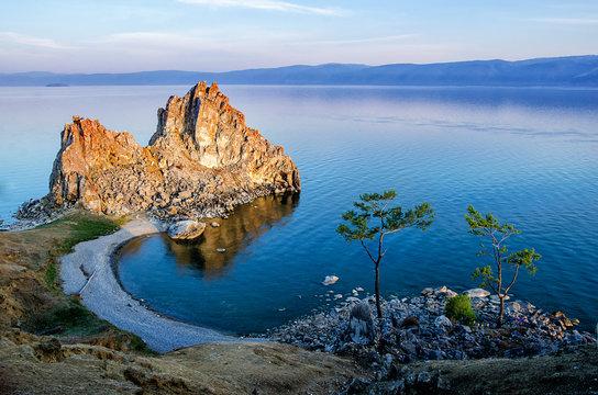 Summer sunset over Rock of Shamanka Burhan on Olkhon Island in Lake Baikal, Russia