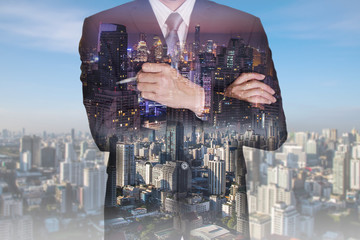 Double exposure of businessman think idea, cityscape,urban in the night and the day as business and leadership concept.