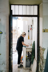 Craftswoman washing tools