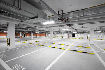 Interior Of Illuminated Underground Parking Lot