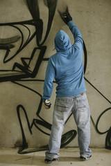 Graffiti writer painting