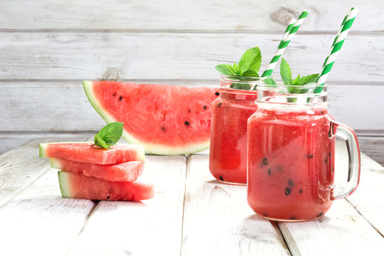 Two summer refreshing smoothie of watermelon and mint on a white background. Top view.