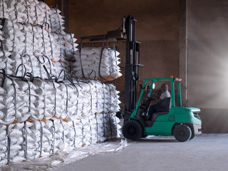 Sugar in bags handling to stacking in warehouse by forklift for export.
