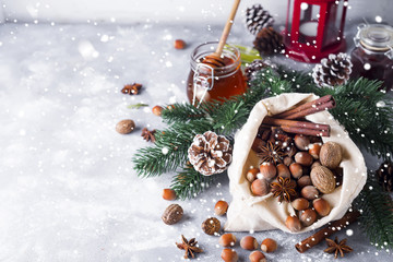 Festive christmas nuts and spices tumbling from a burlap bag