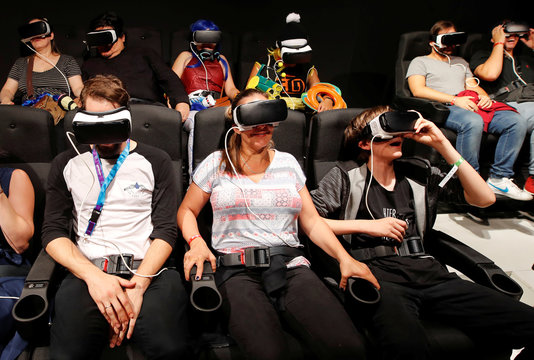 Gamers enjoy VR ride in roller coaster at Gamescom in Cologne