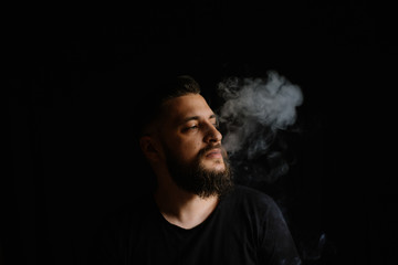 bearded men is smoking