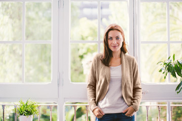 Portrait of a mature woman standing at home.