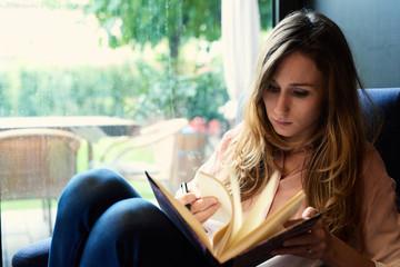 Beautiful woman flipping the notebook