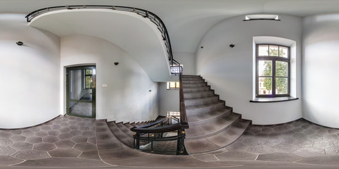 Full spherical 360 by 180 degrees seamless panorama in equirectangular equidistant projection, panorama in interior with staircase in an empty loft. VR content