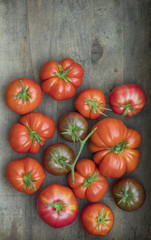 Fresh picked heirloom tomatoes on wood surface