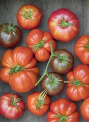 Fresh picked heirloom tomatoes on wood surface