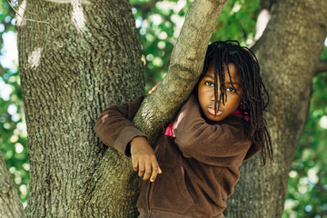 Black girl in a tree