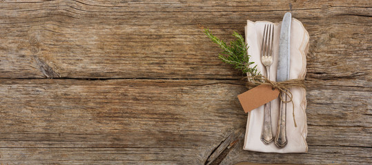 Table setting with tag on wooden background