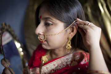 Young Indian woman with decorative Jewellery