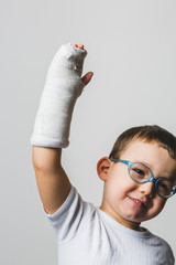 Brave Kid Showing the Arm Cast