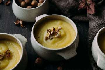 Homemade delicious creamy soup topped with hazelnuts