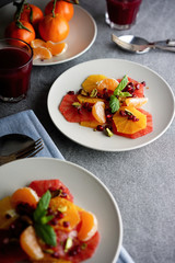 Healthy fruit salad, with citrus and pomegranate.