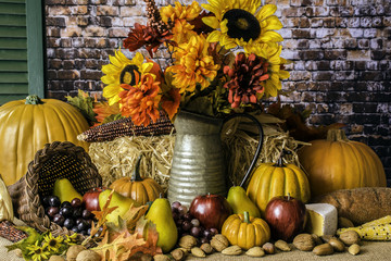 Thanksgiving cornucopia of fruits nuts pumpkins fall flowers and autumn leaves