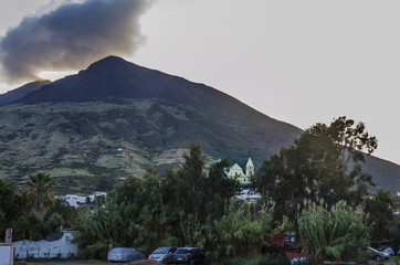 View of stromboli volcano and village from its own island