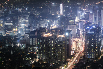 Fantastic view of a big city at night with illuminated modern architecture. Seoul downtown, South Korea