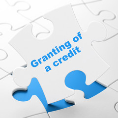 Banking concept: Granting of A credit on puzzle background