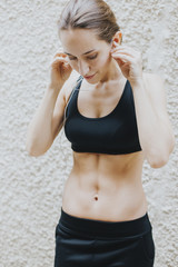 woman listening to music while working out