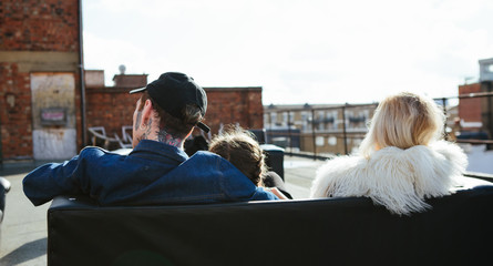 Anonymous people looking out on a view of London from a rooftop terrace