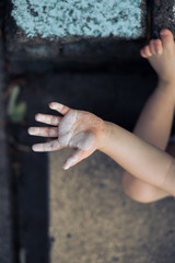 Crop of little hand showing dust