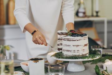 Woman Cutting Christmas Cake