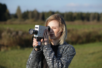 Portrait of girl with retro film camera.