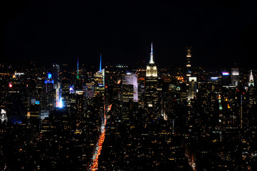 Dramatic picture of the skyline of Midtown Manhattan, New York City at night as can be seen from Downtown