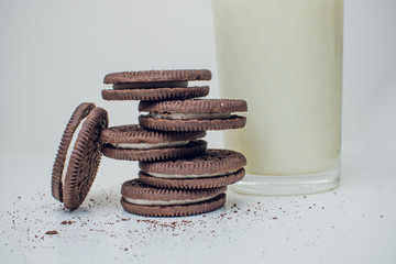 Oreo chocolate cookies stacked, served milk