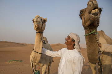 A Man and Two Camels