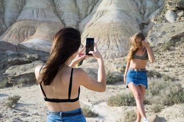 Woman taking shots of friend