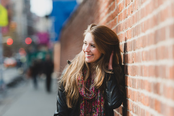 Happy young woman in the city street