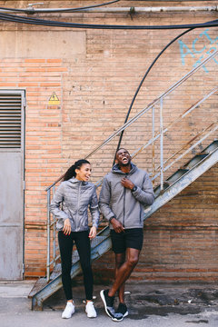 Two runners leaning against staircase