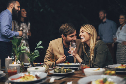 Couple having Fun at The Dinner Party