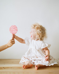 A kid taking lollipop