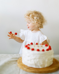 girls eating cake with berries