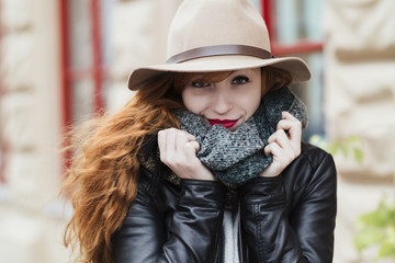 Portrait of a beautiful ginger haired young woman