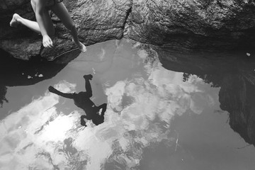 Girl jumping into river.