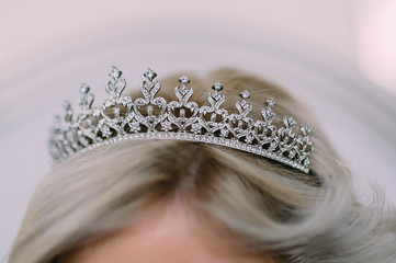 Wedding diadem in a shape of crown on bride's head. Artwork